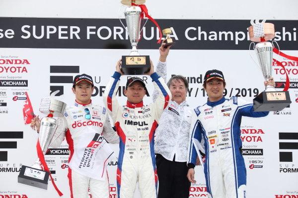 Race Winner Yuhi Sekiguchi, Team Impul, Naoki Yamamoto and Kazuya Oshima, UOMO Sunoco Team LeMans celebrate on the podium with the trophy