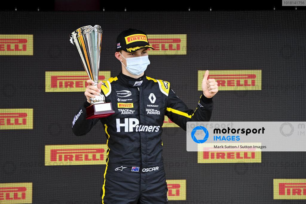 Oscar Piastri (AUS, PREMA RACING) on the podium with the trophy