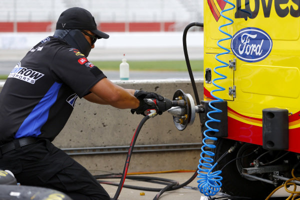 A crew member of Michael McDowell, Front Row Motorsports Ford FR8 Auctions, Copyright: Kevin C. Cox/Getty Images.