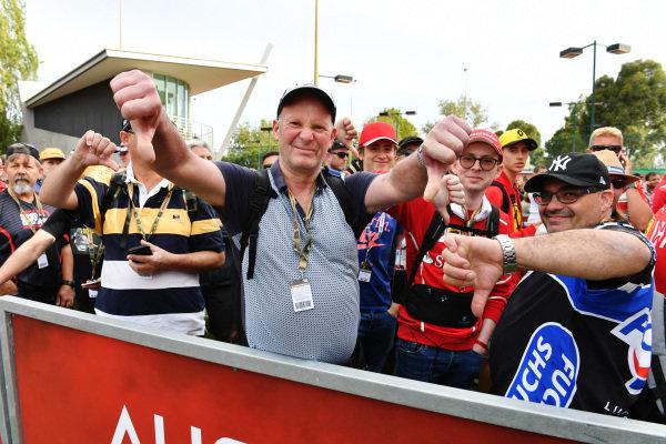 Fans queue at the closed gates