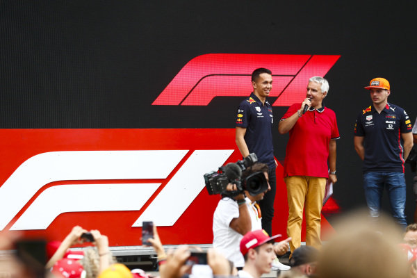 Alexander Albon, Red Bull Racing and Max Verstappen, Red Bull Racing on stage in the fan zone