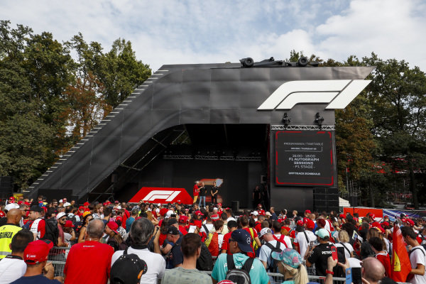 Kevin Magnussen, Haas F1 and Romain Grosjean, Haas F1 on stage in the fan zone