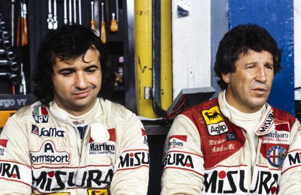 Bruno Giacomelli with Mario Andretti.
