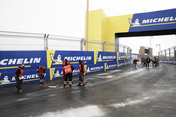 Marshals clear the track