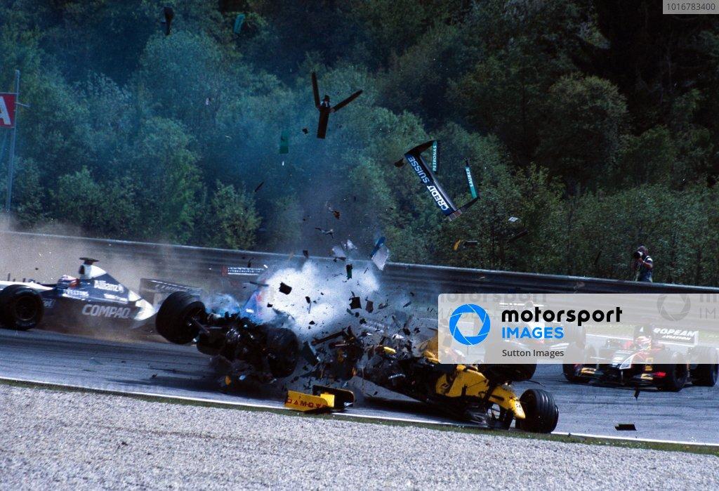 Nick Heidfeld (GER) Sauber Petronas C21 loses control of his car and careers backwards into the side of the Jordan Honda EJ12 of Takuma Sato (JPN). Formula One World Championship, Rd6, Austrian Grand Prix, A1-Ring, Austria. 12 May 2002. DIGITAL IMAGE BEST IMAGE