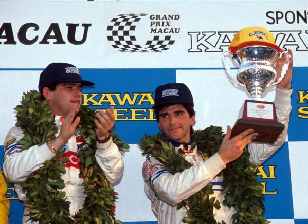 Race winner Enrico Bertaggia (ITA) applauds second place finisher Damon Hill (GBR) as he recieves his trophy.International Formula Three, Macau, Hong Kong, November 27 1988.