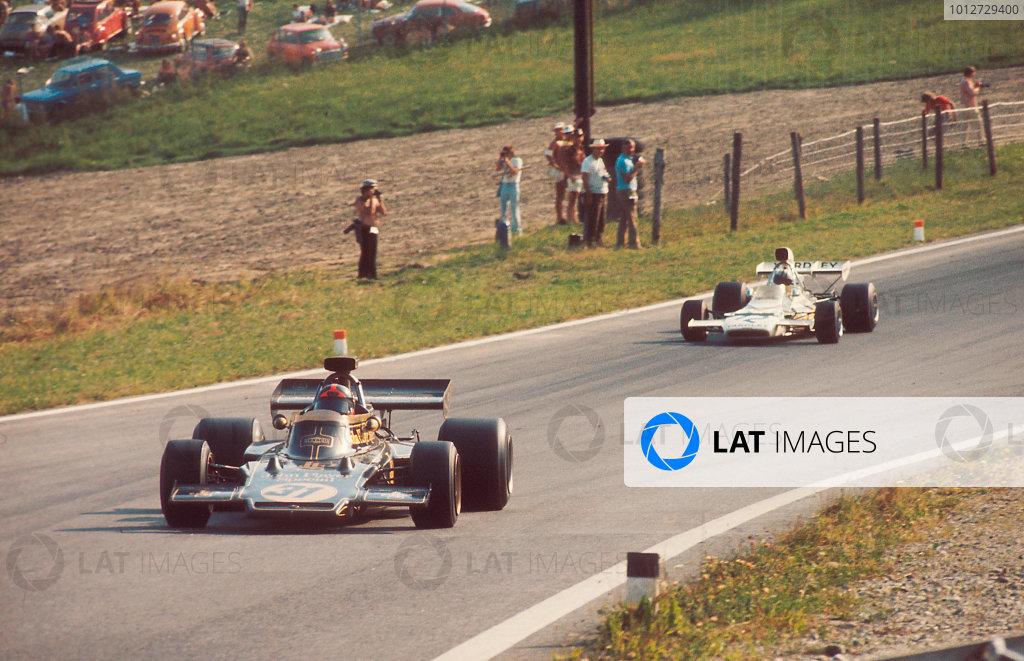 1972 Austrian Grand Prix.Osterreichring, Zeltweg, Austria.11-13 August 1972.Emerson Fittipaldi (Lotus 72D Ford) 1st position leas Denny Hulme (McLaren M19C Ford) 2nd position.Ref-72 AUT 61.World Copyright - LAT Photographic