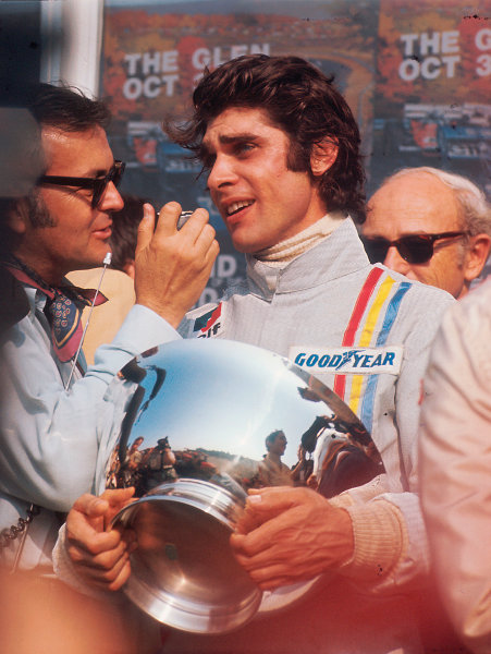 1971 United States Grand Prix.Watkins Glen, New York, USA.1-3 October 1971.Francois Cevert (Tyrrell Ford) 1st position on the podium. This was his only Grand Prix win.Ref-71 USA 66.World Copyright - LAT Photographic