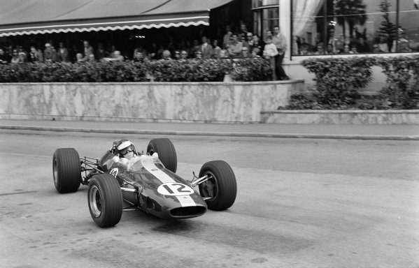 Jim Clark, Lotus 33 Climax, corrects a slide at Casino Square.