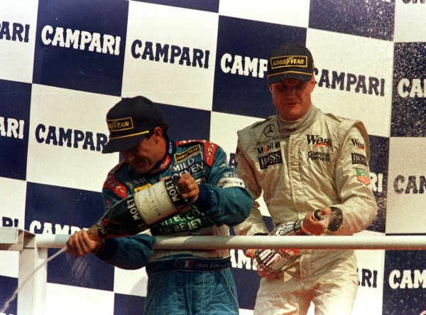 1997 Italian Grand Prix.Monza, Italy.5-7 September 1997.David Coulthard (McLaren Mercedes-Benz) and Jean Alesi (Benetton Renault) after finishing in 1st and 2nd positions respectively.World Copyright - Coates/LAT Photographic