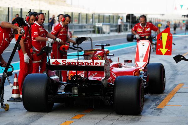 Yas Marina Circuit, Abu Dhabi, United Arab Emirates. Tuesday 28 November 2017. Kimi Raikkonen, Ferrari SF70H, makes a pit stop. World Copyright: Zak Mauger/LAT Images  ref: Digital Image _O3I0558