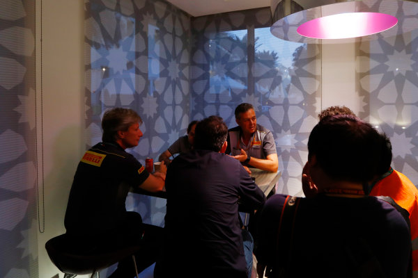 Yas Marina Circuit, Abu Dhabi, United Arab Emirates. Wednesday 29 November 2017. Mario Isola, Racing Manager, Pirelli Motorsport, talks to reporters, including Roberto Chinchero. World Copyright: Joe Portlock/LAT Images  ref: Digital Image _R3I6820