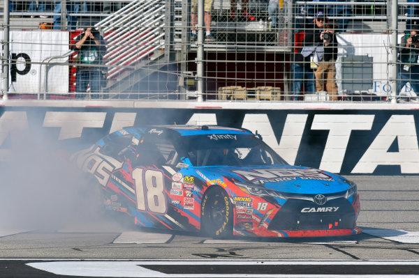 2017 NASCAR XFINITY Series - Rinnai 250 Atlanta Motor Speedway, Hampton, GA USA Saturday 4 March 2017 Kyle Busch, NOS Energy Drink Toyota Camry celebrates his win with a burnout World Copyright: Nigel Kinrade/LAT Images ref: Digital Image 17ATL1nk05571
