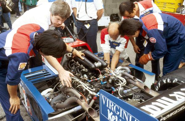 Monza, Italy.9-11 September 1983.Mechanics from the Spirit Racing team look at the Honda RA163-E twin turbo V6 engine.Ref-83 ITA 17.World Copyright - LAT Photographic