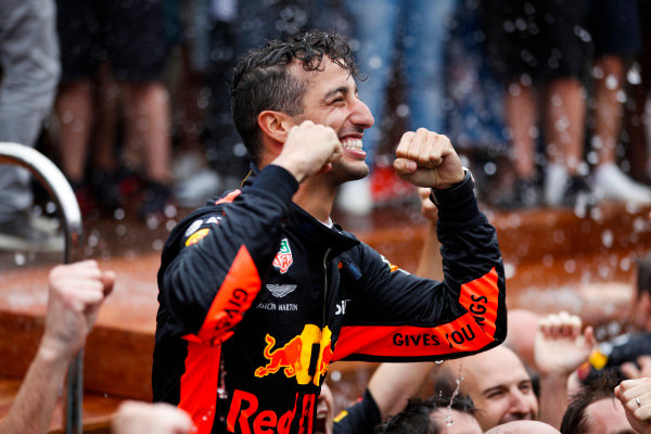 Daniel Ricciardo, Red Bull Racing, 1st position, celebrates by jumping into a swimming pool.