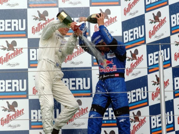 (L-R) Alexander Margaritis (GRE) Weigl Motorsport 2nd (later disqualified) celebrates with champagne on the podium with race winner Christian Klien (AUT) JD Motorsport.