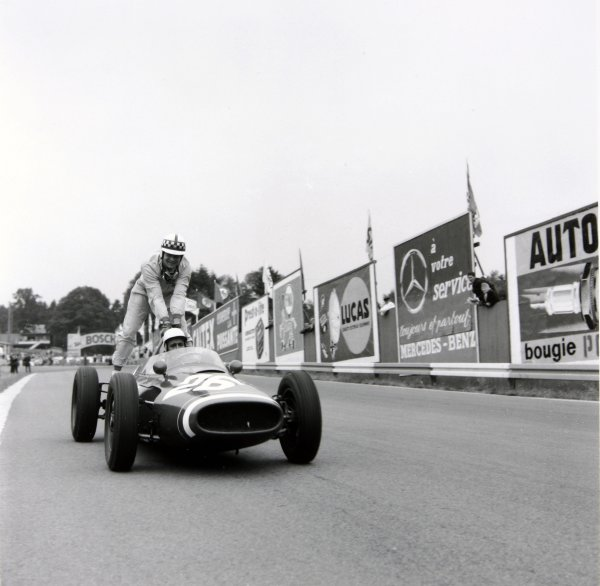 1961 Belgian Grand Prix. Spa-Francorchamps, Belgium. 16-18 June 1961. Innes Ireland (Lotus 21-Climax), retired, hitches a lift back to the pits aboard Maurice Trintignant's (Cooper T51-Maserati), retired, action. World Copyright: LAT Photographic. Ref: 9197.