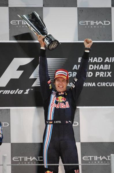 Yas Marina Circuit, Abu Dhabi, United Arab Emirates 1st November 2009. Sebastian Vettel, Red Bull Racing RB5 Renault, 1st position, celebrates victory on the podium. Portrait. Podium.  World Copyright: Steve Etherington/LAT Photographic ref: Digital Image SNE17968