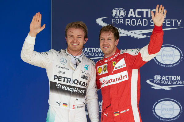 Interlagos, Sao Paulo, Brazil. Saturday 14 November 2015. Pole man Nico Rosberg, Mercedes AMG, with Sebastian Vettel, Ferrari, 3rd on the grid. World Copyright: Steve Etherington/LAT Photographic ref: Digital Image SNE12391