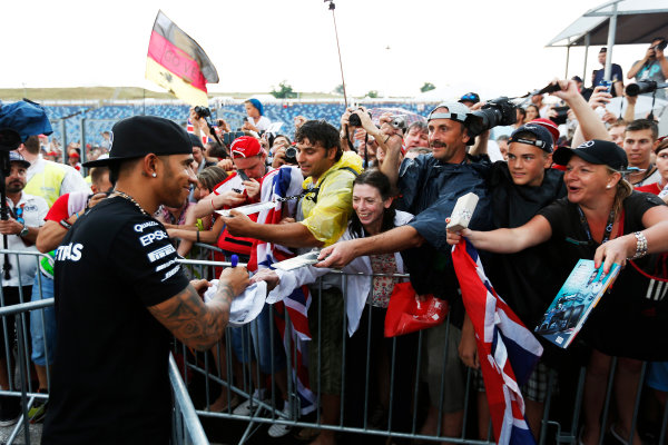Hungaroring, Budapest, Hungary. Thursday 23 July 2015. Lewis Hamilton, Mercedes AMG, signs autographs for fans. World Copyright: Charles Coates/LAT Photographic ref: Digital Image _N7T1821