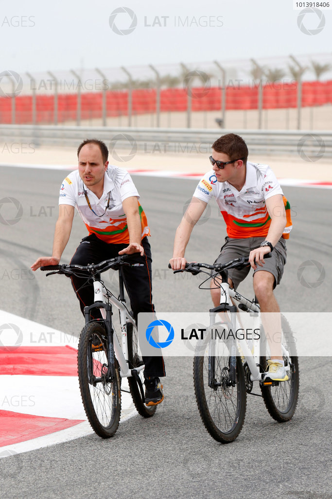 Bahrain International Circuit, Sakhir, Bahrain Thursday 18th April 2013 Paul di Resta, Force India, takes to the track with a team Dietrich Mateschitz, Co-founder and CEO, Red Bull GmbH. on cycles. World Copyright: Charles Coates/LAT Photographic ref: Digital Image _N7T8000