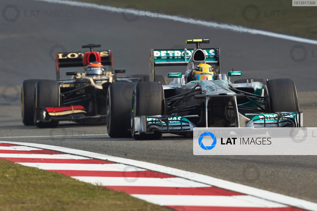 Shanghai International Circuit, Shanghai, China Sunday 13th April 2013 Lewis Hamilton, Mercedes W04, leads Kimi Raikkonen, Lotus E21 Renault. World Copyright: Steve Etherington/LAT Photographic ref: Digital Image SNE16029 copy