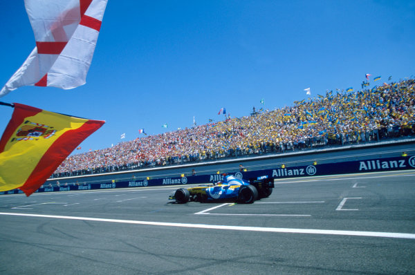 2005 French Grand Prix. Magny-Cours, France. 1st - 3rd July 2005 Fernando Alonso, Renault R25 crosses the line to take victory. Action. World Copyright: Steven Tee/LAT Photographi--c Ref: 35mm Image A10
