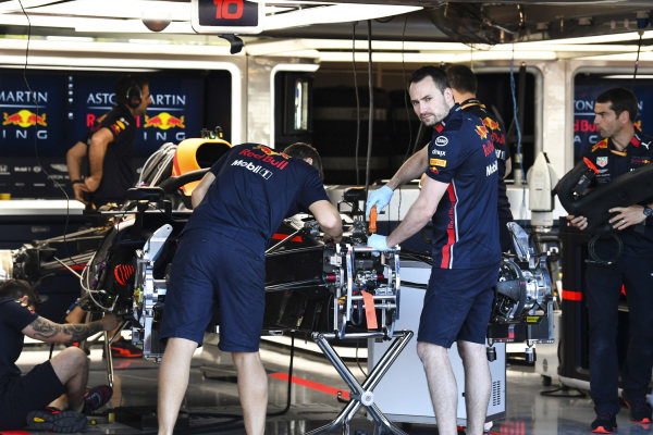 Mechanics working on the front of Red Bull Racing RB15