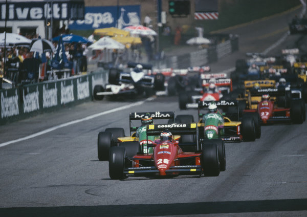 Gerhard Berger, Ferrari F1/87, leads as Riccardo Patrese, Brabham BT56 BMW, collides with Eddie Cheever, Arrows A10 Megatron, at the start.