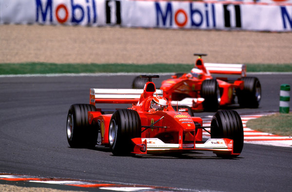2000 French Grand Prix.Magny-Cours, France. 30/6-2/7 2000.Michael Schumacher followed by team mate Rubens Barrichello (both Ferrari F1-2000's).World Copyright - LAT PhotographicFormat: 35mm transparency
