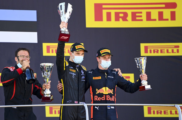 Christian Lundgaard (DNK, ART GRAND PRIX), 1st position,, and Juri Vips (EST, DAMS), 3rd position, on the podium with their trophies