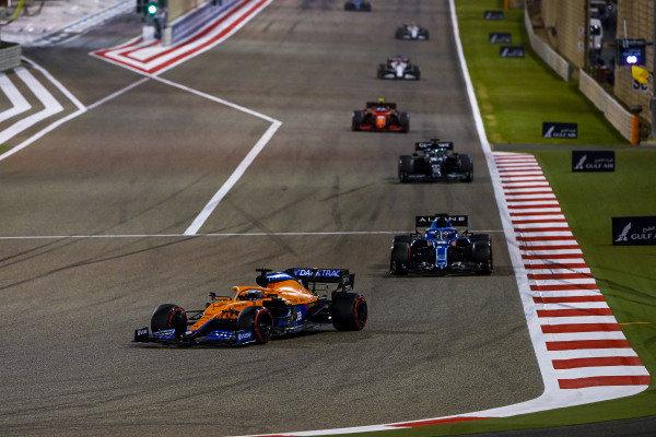 Daniel Ricciardo, McLaren MCL35M, leads Fernando Alonso, Alpine A521, and Lance Stroll, Aston Martin AMR21