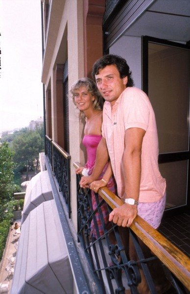 Lido di Venezia, or Venice Lido, 1983. Riccardo Patrese and his wife Susi look out from the balcony of their house