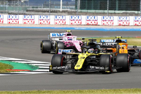 Daniel Ricciardo, Renault R.S.20, leads Lando Norris, McLaren MCL35, and Lance Stroll, Racing Point RP20