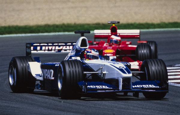 Juan Pablo Montoya, Williams FW23 BMW, gets sideways while leading Rubens Barrichello, Ferrari F2001.
