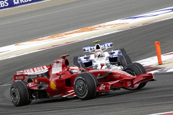 Kimi Räikkönen, Ferrari F2008 leads Robert Kubica, BMW Sauber F1.08.
