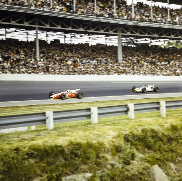 Al Unser, Andy Granatelli, Lotus 38 Ford, leads Graham Hill, John Mecom, Lola T90 Ford.