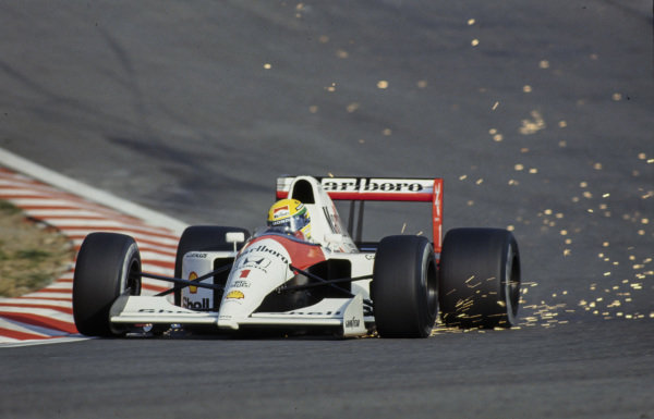 Ayrton Senna, McLaren MP4-6 Honda, with sparks flying at Eau Rouge.