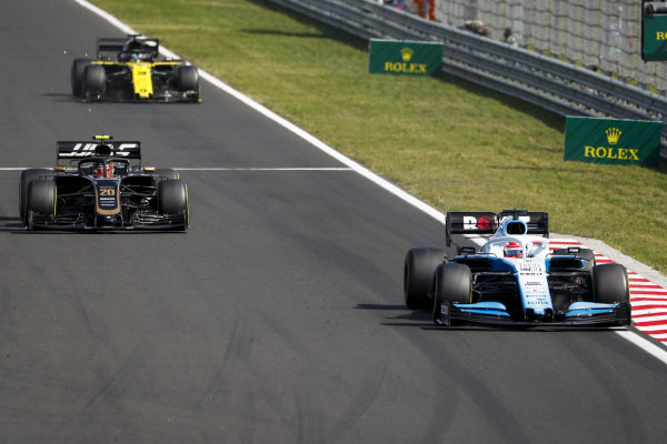 George Russell, Williams Racing FW42, leads Kevin Magnussen, Haas VF-19, and Daniel Ricciardo, Renault R.S.19