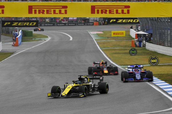 Daniel Ricciardo, Renault R.S.19, leads Daniil Kvyat, Toro Rosso STR14, and Pierre Gasly, Red Bull Racing RB15