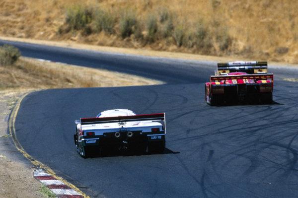 Gianpiero Moretti / Frank Jelinski, Momo/Gebhardt Racing, Porsche 962 C, leads Davy Jones / John Nielsen, Tom Walkinshaw Racing, Jaguar XJR-9.