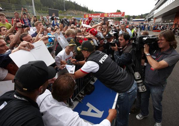 Spa-Francorchamps, Spa, Belgium 25th August 2011. Michael Schumacher, Mercedes GP W02, signs autographs for fans. Portrait. Atmosphere.  World Copyright: Steve Etherington/LAT Photographic ref: Digital Image SNE26538