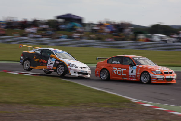 Snetterton, Nortfolk.2nd AugustWorld Copyright: Malcolm Griffiths/LAT Photographicref: Digital Image IMG_6264 JPGColin Turkington (GBR) Team RAC/BMW 329si E90Paul O'Neill (GBR) Sunshine.co uk Tech-Speed Motorsport/Honda Integra