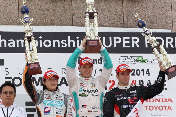 2014 Super Formula Series Autopolis, Japan. 13th - 14th September 2014. Rd 5. Winner Andre Lotterer ( #36 PETRONAS TOM'S SF14 ) 2nd position Yuji Kunimoto ( #39 P.MU / CERUMO?INGING SF14 ) 3rd position Joao Paulo de Oliveira ( #19 Lenovo TEAM IMPUL SF14 ) podium, portrait World Copyright: Masahide Kamio / LAT Photographic. Ref:  2014SF_Rd5_005.JPG