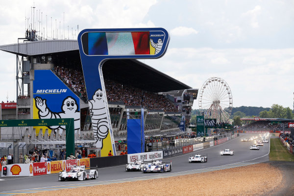 2014 Le Mans 24 Hours. Circuit de la Sarthe, Le Mans, France. Saturday 14 June 2014. Romain Dumas (FRA), Neel Jani (CHE), Marc Lieb (DEU) - Porsche Team, Porsche 919 - Hybrid, followed by Anthony Davidson (GBR), Nicolas Lapierre (FRA), Sebastien Buemi (CHE) - Toyota Racing, Toyota TS 040 - Hybrid & Time Bernhard (DEU), Mark Webber (AUS), Brendon Hartley (NZL) - Porsche Team, Porsche 919 - Hybrid  Photo: Sam Bloxham/LAT ref: Digital Image _SBL0732