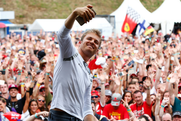 Hockenheim, Germany. Saturday 30 July 2016. Nico Rosberg, Mercedes AMG, takes a photo an an event for fans. World Copyright: Andy Hone/LAT Photographic ref: Digital Image _ONY7769