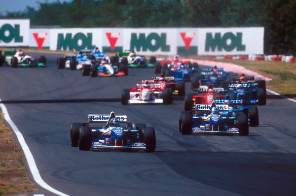Hungaroring, Hungary.11-13 August 1995.Damon Hill leads teammate David Coulthard (both Williams FW17 Renault's), Michael Schumacher (Benetton B195 Renault) and Gerhard Berger (Ferrari 412T2) early on.Ref-95 AUT 05.World Copyright - LAT Photographic