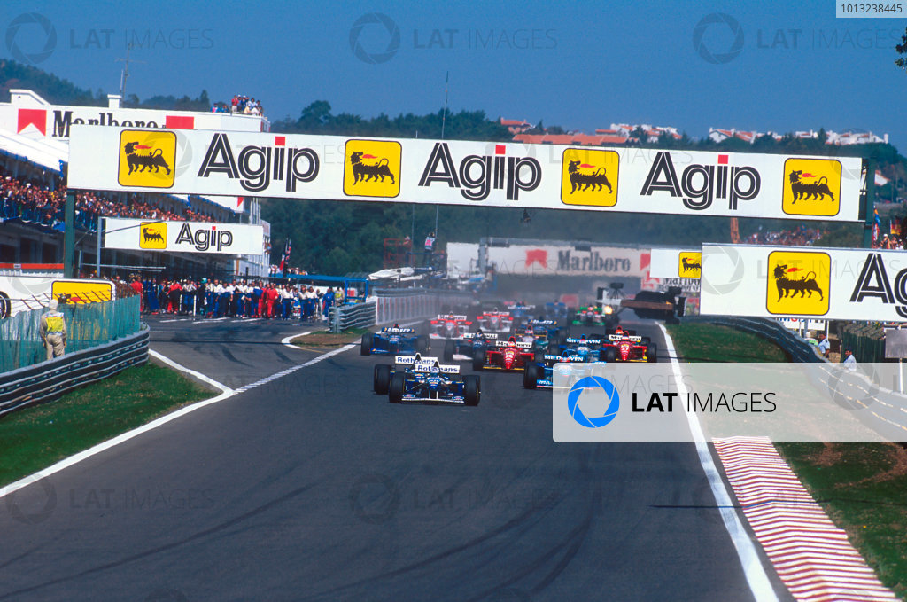 Estoril, Portugal.22-24 September 1995.David Coulthard leads teammate Damon Hill (both Williams FW17 Renault's), Michael Schumacher (Benetton Renault) and Gerhard Berger (Ferrari 412T2) at the start. Ref-95 POR 08.World Copyright - LAT Photographic