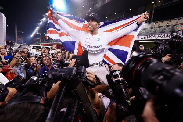 Yas Marina Circuit, Abu Dhabi, United Arab Emirates. Sunday 23 November 2014.  Lewis Hamilton, Mercedes AMG, celebrates championship victory.  World Copyright: Steve Etherington/LAT Photographic. ref: Digital Image SNE13429