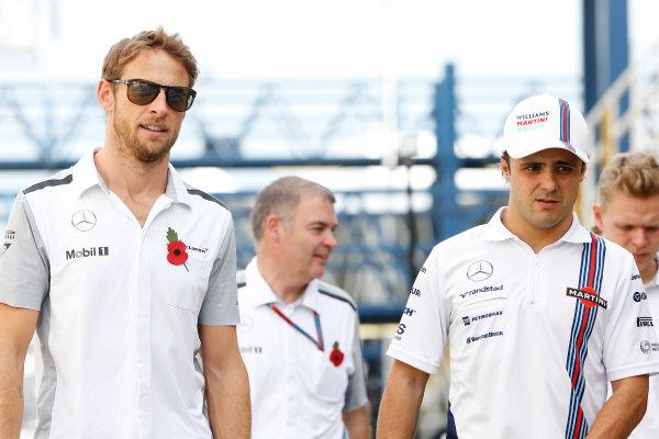 Interlagos, Sao Paulo, Brazil. Friday 7 November 2014. Jenson Button, McLaren, and Felipe Massa, Williams F1. World Copyright: Charles Coates/LAT Photographic. ref: Digital Image _J5R3181